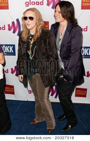 LOS ANGELES - APR 10: Melissa Etheridge (L) and guest arrive at the 22nd annual GLAAD Media Awards at Westin Bonaventure Hotel on April 10, 2011 in Los Angeles, CA.