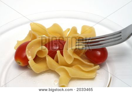 Noodles With Red Tomatoes And A Fork