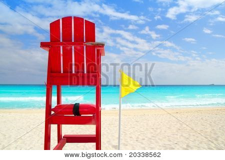 Baywatch red beach seat yellow wind flag in tropical caribbean sea