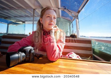 Young woman tourist aside on sea.
