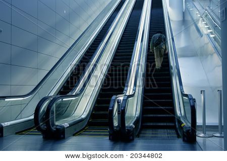 Man on escalator in newly opened airport