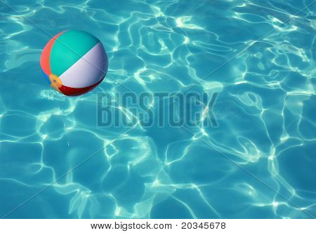 Beach Ball in Pool with sun reflection