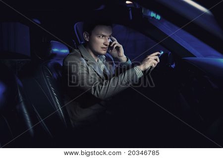Elegant man driving and talking over cellphone