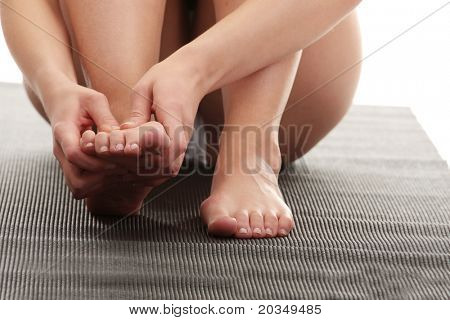 Woman touching her leg - pain concept
