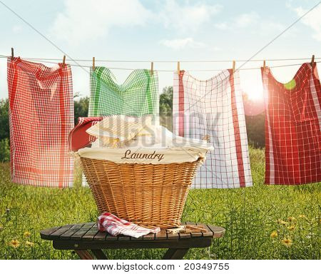 Cotton towels drying on the clothesline with sunny blue sky
