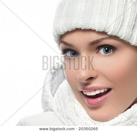 beautiful woman in warm clothing on white background smiling