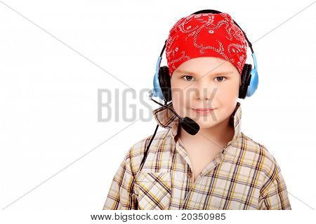 Little fuuny boy in headphone. Isolated over white background.