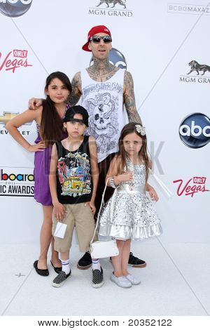LAS VEGAS - MAY 22:  Travis Baker, children arriving at the 2011 Billboard Music Awards at MGM Grand Garden Arena on May 22, 2010 in Las Vegas, NV.