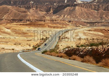 Highway in the desert among mountains of Ramon Crater (Machtesh Ramon) in Israel.