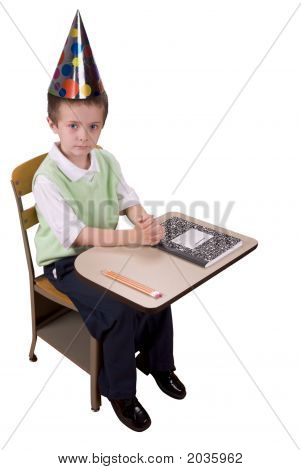 Boy At School Desk With Hat