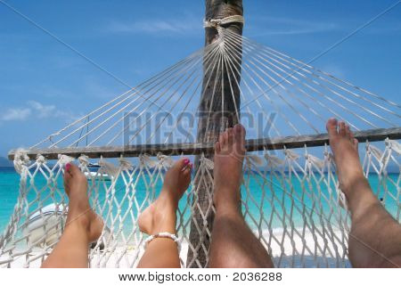 Relaxing With Partner In Caribbean Hammock