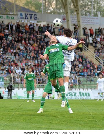 KAPOSVAR, HUNGARY - APRIL 27: Robert Szepessy (in white) in action at a Hungarian National Championship soccer game - Kaposvar vs Ferencvaros on April 27, 2011 in Kaposvar, Hungary.