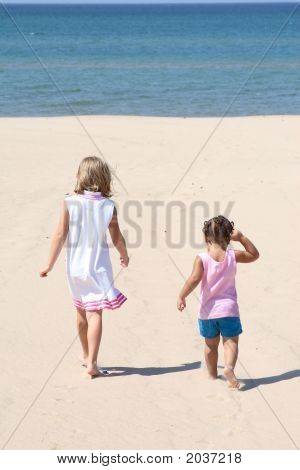 Two Kids Walking On The Beach