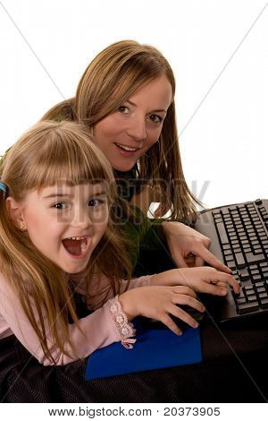 daughter and mother working on the computer