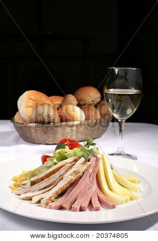 delicious chicken and ham salad served with bread and white wine, copy space included
