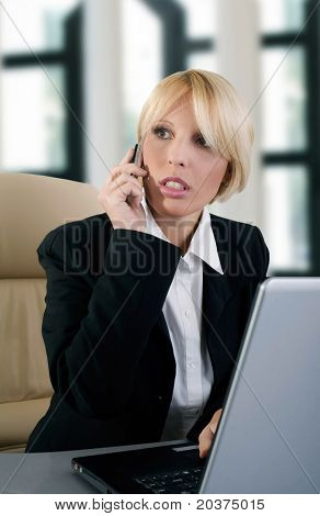 young businesswoman speaking on the phone, problem solving