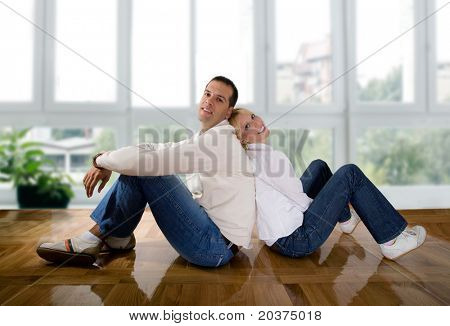 young couple in love at the empty house