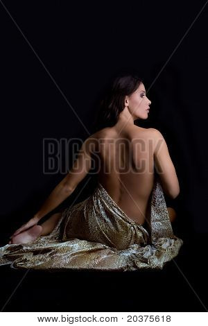 naked back of a beautiful woman, dramatic light
