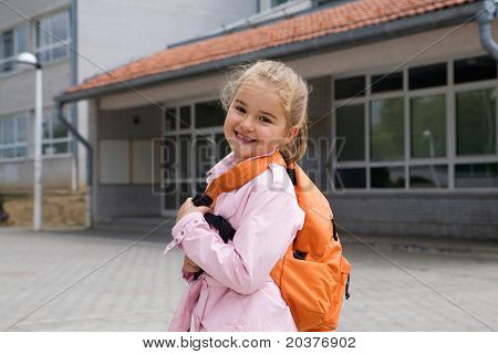 first grade student going to school