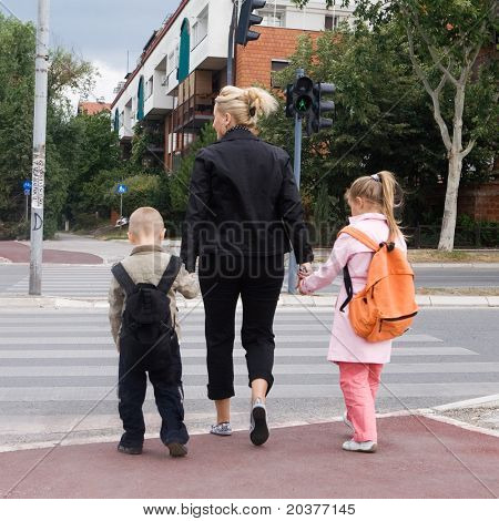 mother taking the children across the street