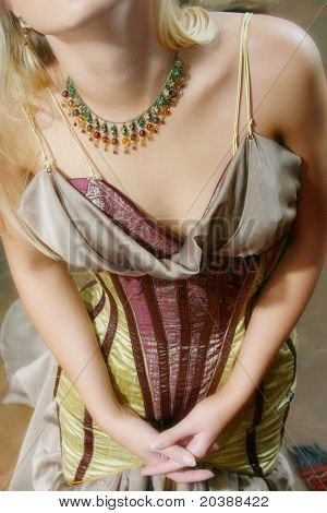 corset dress and necklace