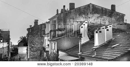 old houses and lamps on the street in Cannes, France - black and white