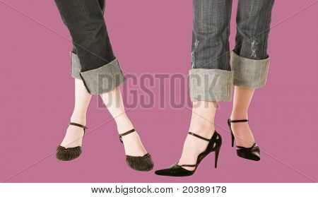 legs of two women - showing off leather shoes - clipping path incl