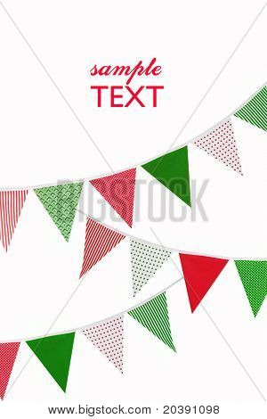 festive red, green and white bunting flags on white background with space for text