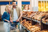 Couple In Grocery Shop poster