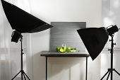 Professional photo equipment and composition with smoothie in studio. Concept of food photography poster