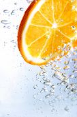 slice of orange in bubbly drink