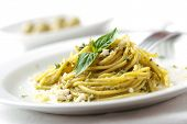 stock photo of italian food  - spaghetti with pesto sauce and cheese - JPG