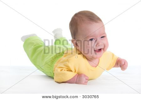 Smiling Baby On Bed
