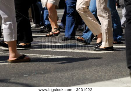 People Crowd Crossing The Street