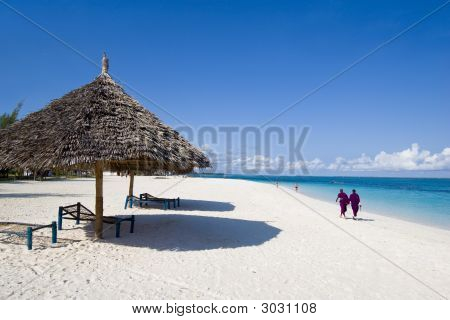 Locals Walking On Beach In Zanzibar