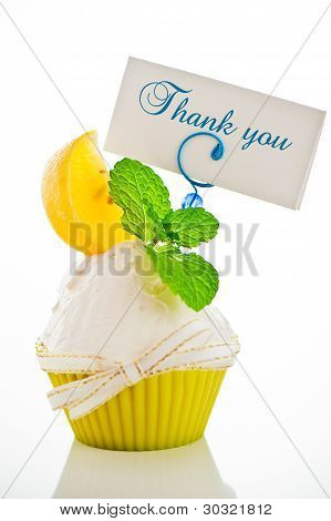 A Refreshing Lemon Cupcake With A Leaf Of Mint And A Label For Your Text On White Background As A St