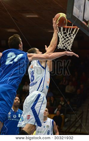 KAPOSVAR, HUNGARY – FEBRUARY 18: Unidentified players in action at a Hungarian Championship basketball game with Kaposvar (white) vs. Fehervar (blue) on February 18, 2012 in Kaposvar, Hungary.