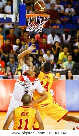 KUALA LUMPUR - FEBRUARY 19:Slingers Donald Little (14) and Dragons Brian Williams (33) rebound for the ball at an ASEAN Basketball League match on February 19, 2012 in Kuala Lumpur, Malaysia.  Dragons won 86-71.