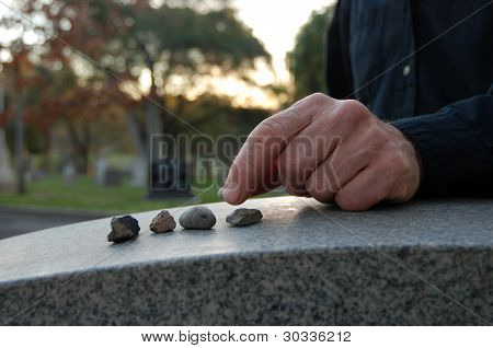 Leaving Pebbles On Headstone