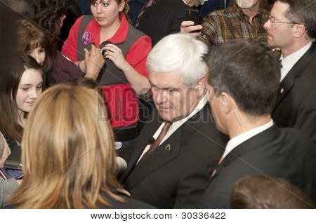 Newt greets supporters.