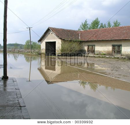 Old building by a flooded road