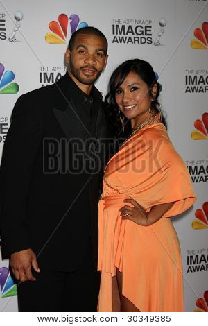 LOS ANGELES - FEB 17:  Aaron D Spears, wife arrives at the 43rd NAACP Image Awards at the Shrine Auditorium on February 17, 2012 in Los Angeles, CA