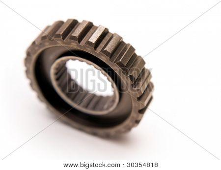 Metal gear on plain background