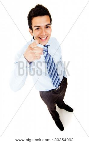 Businessman pointing at the camera - isolated over a white background