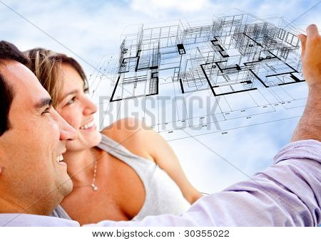 Couple with the blueprints of their dream house
