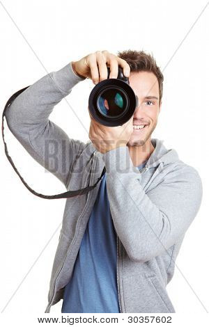 Happy man taking pictures with digital camera