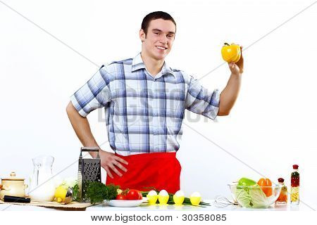 Man cooking fresh meal at home