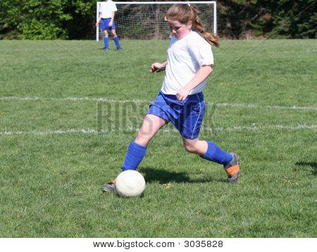 Youth Teen Kicking Soccer Ball 2