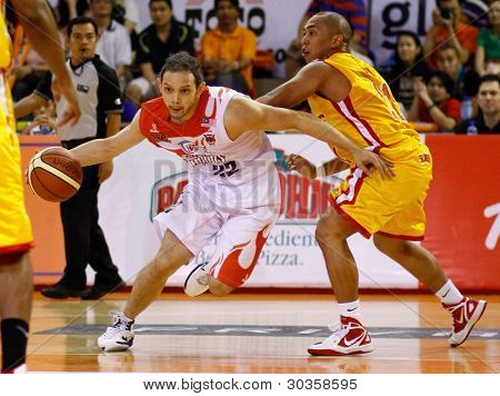 KUALA LUMPUR - FEBRUARY 19: Malaysian Dragons' Ernani Pacana (22) drives to the hoop at the ASEAN Basketball League match against Singapore Slingers on Feb 19, 2012 in Kuala Lumpur, Malaysia. Dragons won 86-71.