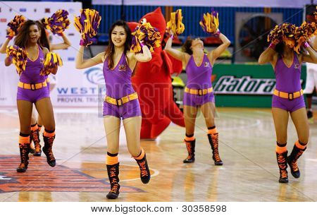 KUALA LUMPUR - FEBRUARY 19: Cheerleaders of the Malaysian Dragons in a dance routine at the start of the ASEAN Basketball League match on February 19, 2012 in Kuala Lumpur, Malaysia. Dragons won their match.
